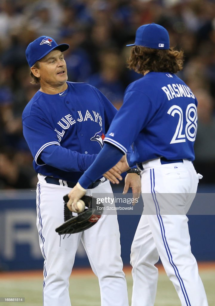John Gibbons #5 of the Toronto Blue Jays congratulates Colby Rasmus #28 during MLB game action after defeating the Boston Red Sox on April 6, 2013 at Rogers Centre in Toronto, Ontario, Canada.