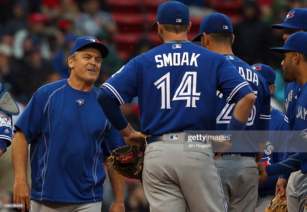 <a gi-track='captionPersonalityLinkClicked' href=/galleries/search?phrase=John+Gibbons&family=editorial&specificpeople=218120 ng-click='$event.stopPropagation()'>John Gibbons</a> #5 of the Toronto Blue Jays smiles as he relieves <a gi-track='captionPersonalityLinkClicked' href=/galleries/search?phrase=Marco+Estrada+-+Baseball+Player&family=editorial&specificpeople=7030137 ng-click='$event.stopPropagation()'>Marco Estrada</a> #25 in the ninth inning after he gave up his second hit at Fenway Park on June 5, 2016 in Boston, Massachusetts. He had a no hitter until the eighth inning.