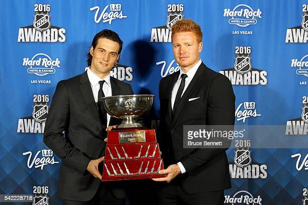 John Gibson and Federik Andersen of the Anaheim Ducks pose after sharing the William M Jennings Trophy awarded to the goalie who plays at least 25...