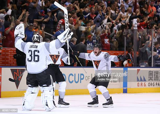 John Gibson and Nathan MacKinnon of Team North America celebrate after defeating Team Sweden 43 in overtime during the World Cup of Hockey 2016 at...