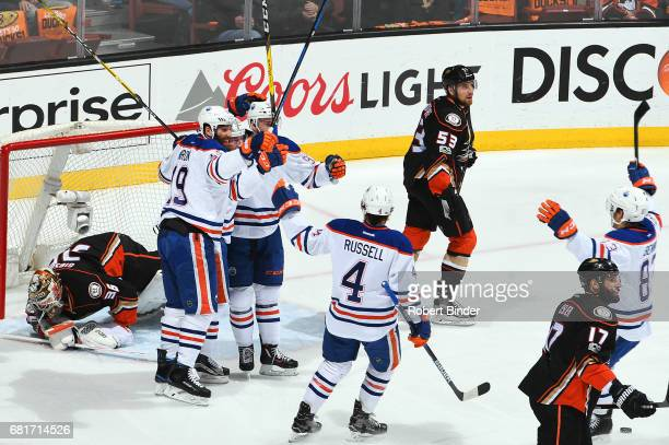 John Gibson and Ryan Kesler of the Anaheim Ducks react as Patrick Maroon Drake Caggiula Connor McDavid Kris Russell and Matthew Benning of the...