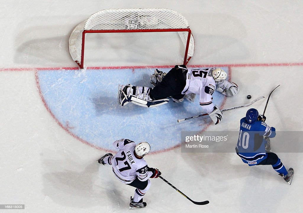John Gibson (C), goaltender of USA makes a save on <a gi-track='captionPersonalityLinkClicked' href=/galleries/search?phrase=Niklas+Hagman&family=editorial&specificpeople=203179 ng-click='$event.stopPropagation()'>Niklas Hagman</a> (#10) of Finland during the IIHF World Championship group H match between USA and Finland at Hartwall Areena on May 8, 2013 in Helsinki, Finland.