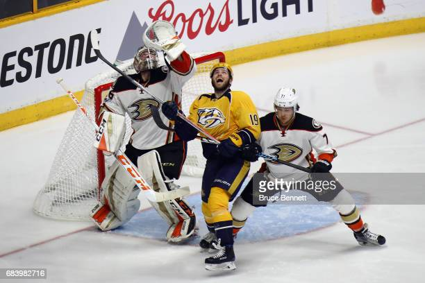 John Gibson of the Anaheim Ducks and Calle Jarnkrok of the Nashville Predators look up at the puck during the second period in Game Three of the...