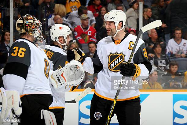 John Gibson of the Anaheim Ducks celebrates with John Scott of the Arizona Coyotes after defeating the Central Division AllStars during the Western...