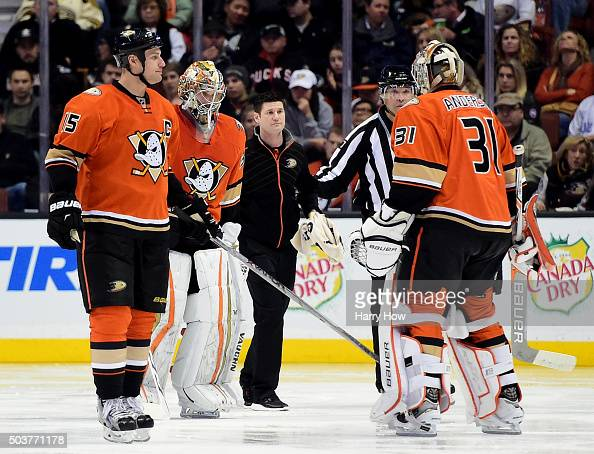 John Gibson of the Anaheim Ducks leaves the ice as he is replaced after an injury by Frederik Andersen as Ryan Getzlaf of the Anaheim Ducks watches...