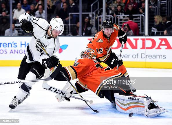 John Gibson of the Anaheim Ducks stops Kyle Clifford of the Los Angeles Kings on a shot in front of Sami Vatanen during the second period at Staples...