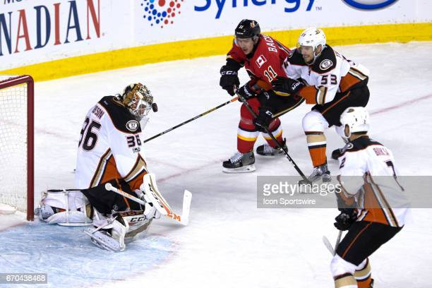 John Gibson uses his head to save a shot from of the Calgary Flames forward Mikael Backlund during game 4 of the first round of the Stanley Cup...