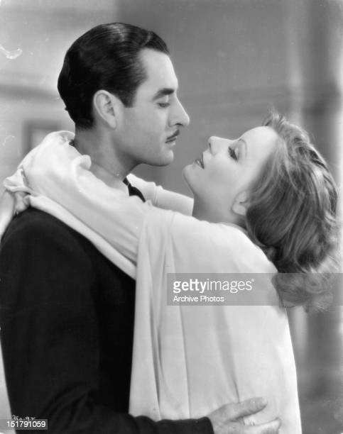 John Gilbert and Greta Garbo embrace in a scene from the film 'Woman Of Affairs' 1941