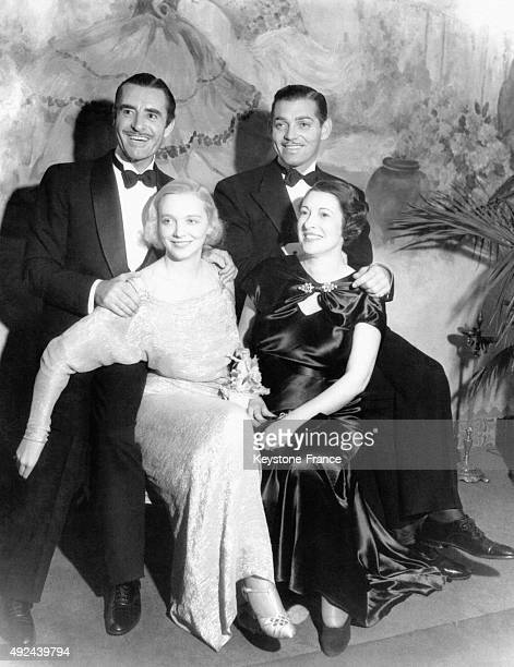 John Gilbert and his wife Virginia Bruce with Clark Gable and his wife Maria Langham on November 22 1933 in Hollywood California United States
