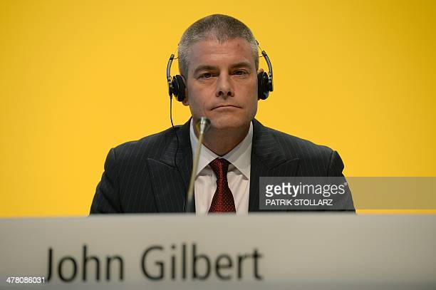 John Gilbert board member of Deutsche Post DHL attends his company's annual results press conference on March 12 2014 in Bonn western Germany...