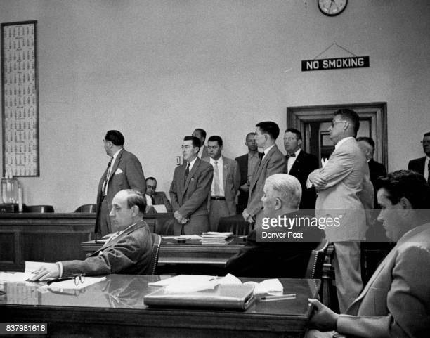 John Gilbert Graham fixes his eyes on a calendar as District Judge Joseph M McDonald sets the 'week of Aug 26' for Graham's gas chamber execution for...