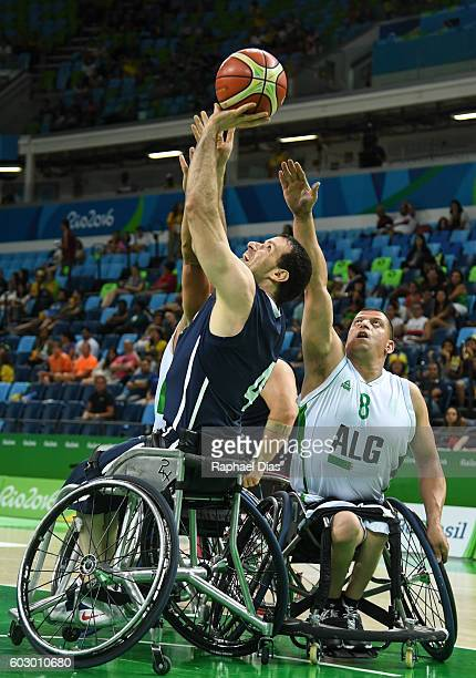 John Gilbert of USA and Mostefa Abassi of Algeria during Wheelchair Basketball match United States against Algeria during Rio 2016 Paralympics at...