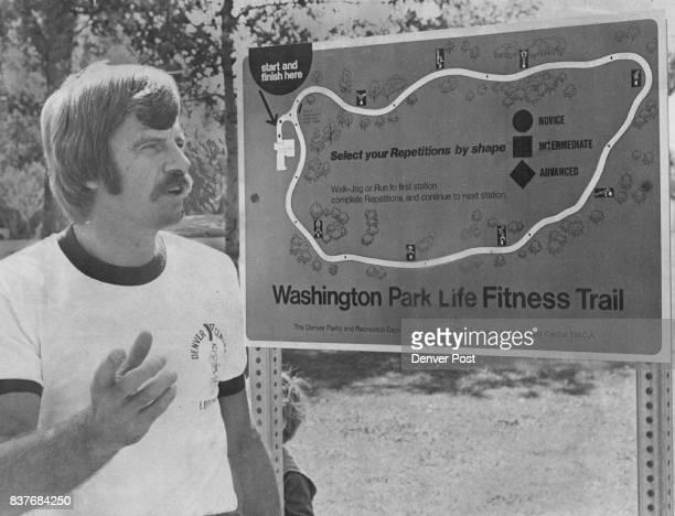 John Gillingham Shows Instruction Sign For Fitness Trail The tail is brainchild of Gillingham former YMCA physical fitness director Credit Denver Post