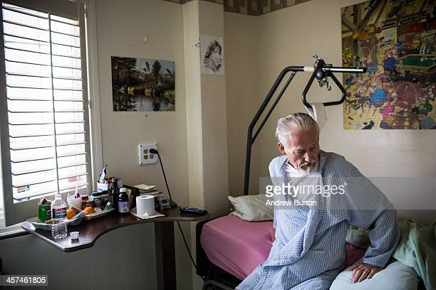 John Gillis age 73 a hospice care patient diagnosed with terminal colon cancer relaxes in his bed in the hospice care wing of California Medical...