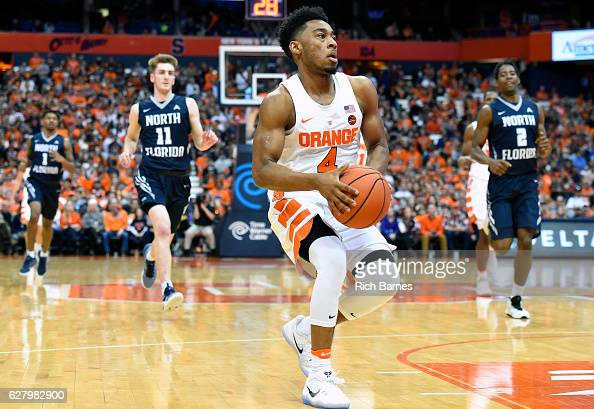 John Gillon of the Syracuse Orange drives to the basket against the North Florida Ospreys during the first half at the Carrier Dome on December 3...