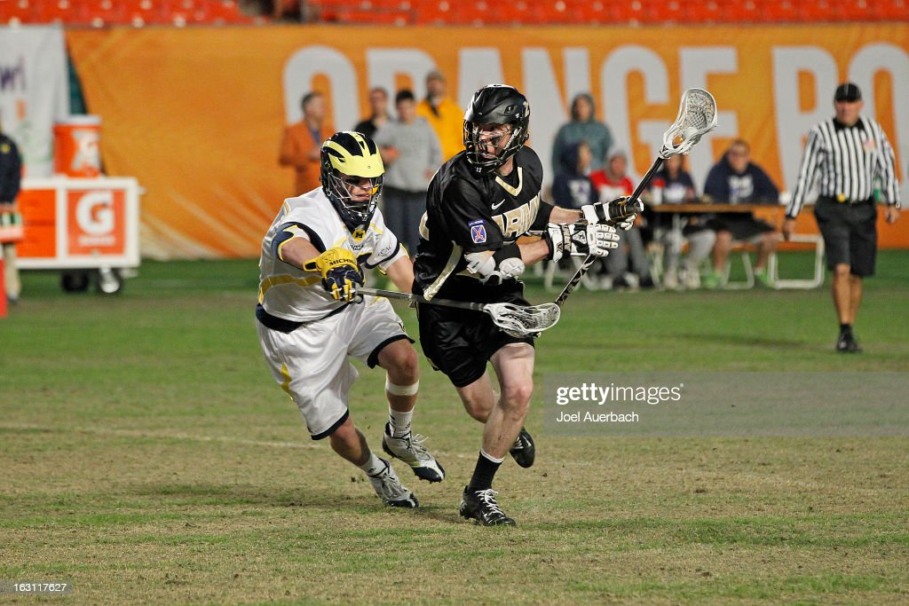 John Glesener #21 of the Army Black Knights carries the ball while being defended by Thomas Orr #43 of the Michigan Wolverines during the 2013 Orange Bowl Lacrosse Classic on March 2, 2013 at SunLife Stadium in Miami Gardens, Florida. Army defeated Michigan 12-1.