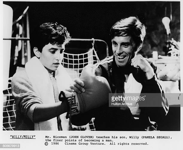 John Glover teaches Pamela Adlon boxing in a scene from the movie 'Willy/Milly' circa 1986