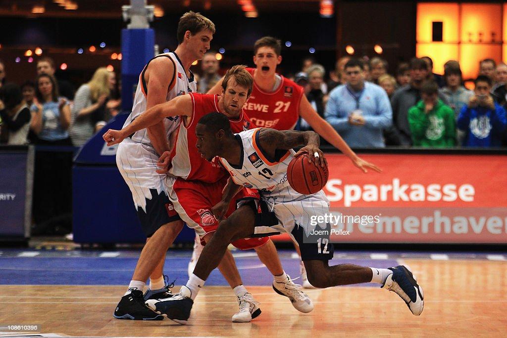 John Goldsberry of Brose Baskets moves against Torrell Martin of Bremerhaven during the Basketball Bundesliga match between Eisbaeren Bremerhaven and...