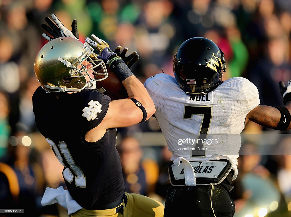 John Goodman #81 of the Notre Dame Fighting Irish catches a touchdown pass next to Merrill Noel #7 of the Wake Forest Demon Deacons at Notre Dame Stadium on November 17, 2012 in South Bend, Indiana.