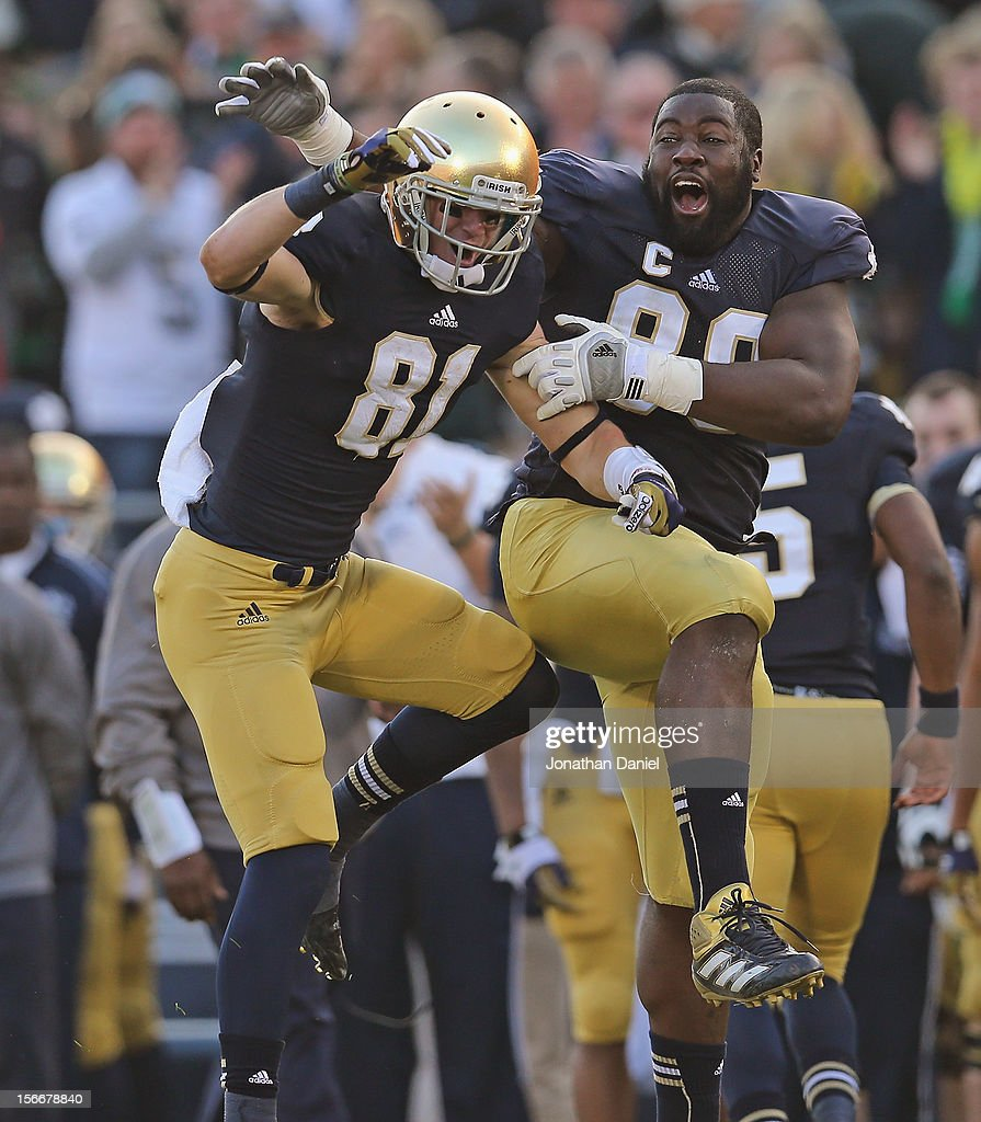 John Goodman #81 of the Notre Dame Fighting Irish (L) celebrates with Kapron Lewis-Moore #89 after catching a touchdown pass against the Wake Forest Demon Deacons at Notre Dame Stadium on November 17, 2012 in South Bend, Indiana. Notre Dame defeated Wake Forest 38-0.