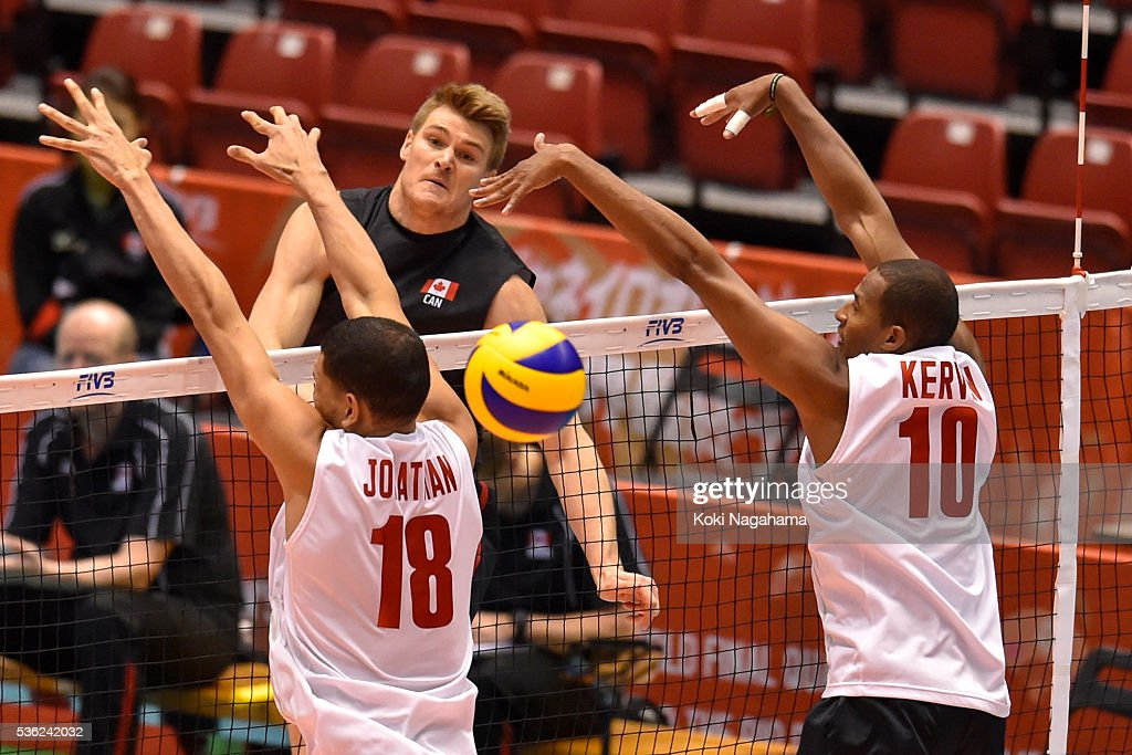 John Gordon Perrin #2 of Canada spikes the ball during the Men's World Olympic Qualification game between Venezuela and Canada at Tokyo Metropolitan Gymnasium on June 1, 2016 in Tokyo, Japan.