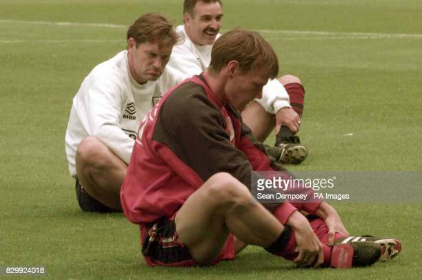John Gorman assistant manager looks in a clearly lighter mood that Teddy Sheringham and manager Glenn Hoddle during a warmup session in Nantes this...