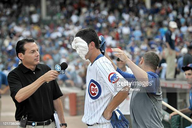 John Grabow of the Chicago Cubs smashes a shaving cream pie in the face of teammate Tyler Colvin after Colvin hit a gamewinning RBI single scoring...