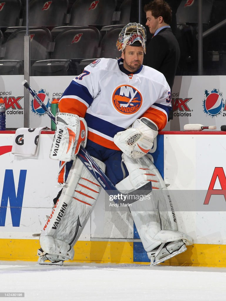 <a gi-track='captionPersonalityLinkClicked' href=/galleries/search?phrase=John+Grahame&family=editorial&specificpeople=201491 ng-click='$event.stopPropagation()'>John Grahame</a> #37 of the New York Islanders looks on during warmups against the New Jersey Devils at the Prudential Center on April 3, 2012 in Newark, New Jersey.
