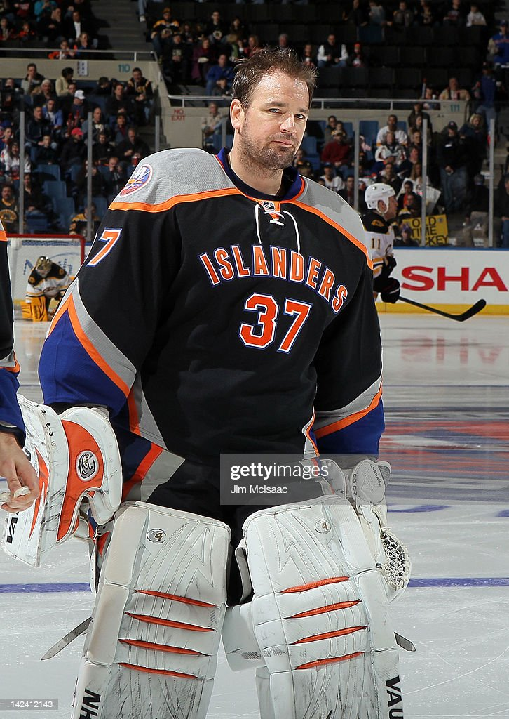 <a gi-track='captionPersonalityLinkClicked' href=/galleries/search?phrase=John+Grahame&family=editorial&specificpeople=201491 ng-click='$event.stopPropagation()'>John Grahame</a> #37 of the New York Islanders prepares to play against the Boston Bruins on March 31, 2012 at Nassau Coliseum in Uniondale, New York.