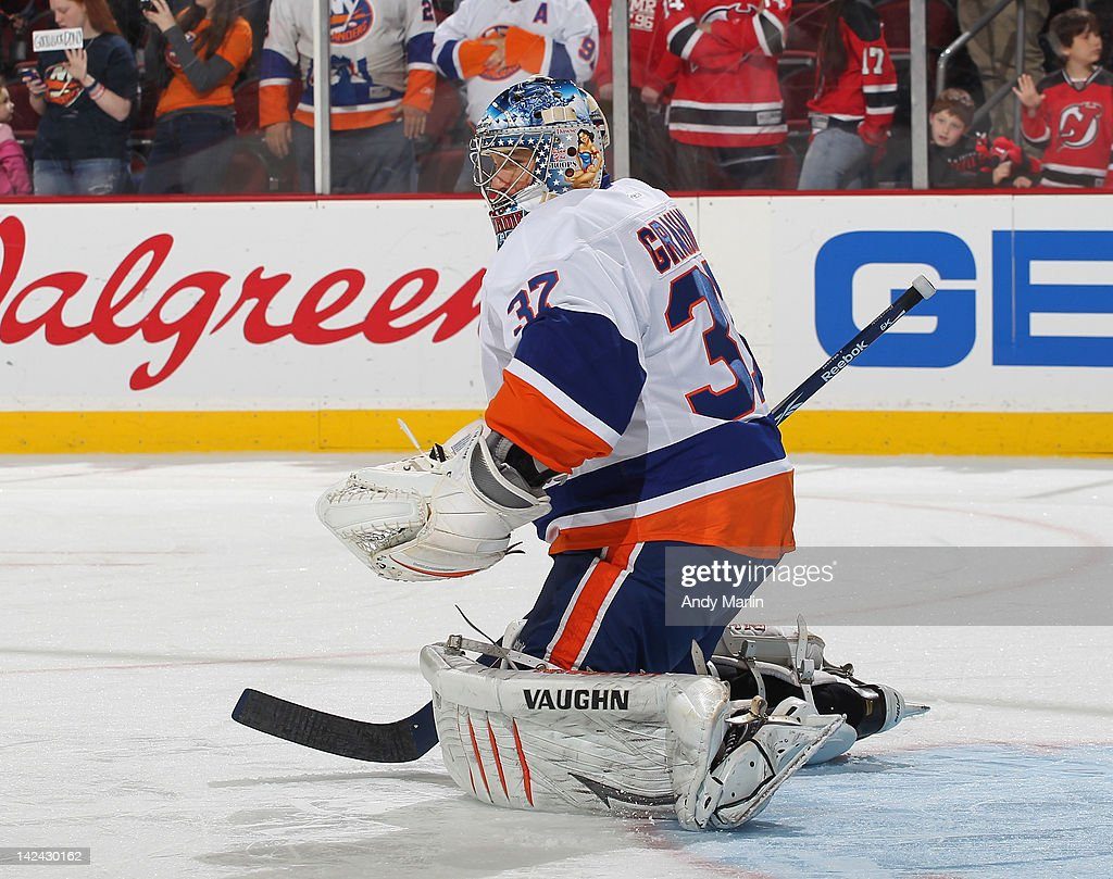 <a gi-track='captionPersonalityLinkClicked' href=/galleries/search?phrase=John+Grahame&family=editorial&specificpeople=201491 ng-click='$event.stopPropagation()'>John Grahame</a> #37 of the New York Islanders tends net during warmups against the New Jersey Devils at the Prudential Center on April 3, 2012 in Newark, New Jersey.