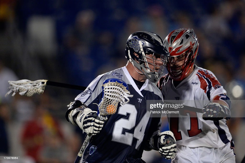 John Grant Jr. #24 of Chesapeake Bayhawks runs past Kyle Sweeney #77 of Boston Cannons during a game at Navy-Marine Corps Memorial Stadium on July 18, 2013 in Annapolis, Maryland.