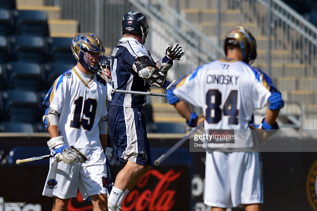 John Grant Jr. #24 of the Chesapeake Bayhawks celebrates a goal between a dejected <a gi-track='captionPersonalityLinkClicked' href=/galleries/search?phrase=Kevin+Drew+-+Lacrosse+Player&family=editorial&specificpeople=14832467 ng-click='$event.stopPropagation()'>Kevin Drew</a> #19 and Joe Cinosky #84 of the Charlotte Hounds during the MLL Championship at PPL Park on August 25, 2013 in Chester, Pennsylvania.