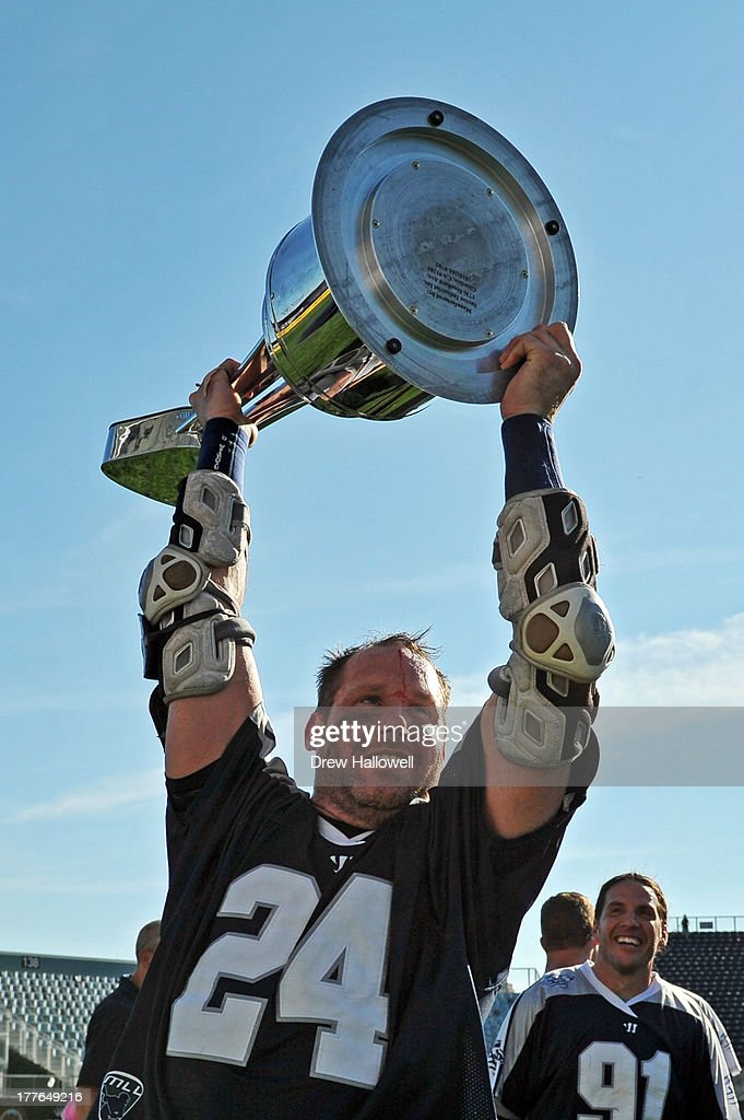 MVP John Grant Jr. #24 of the Chesapeake Bayhawks holds the trophy after beating the Charlotte Hounds 10-9 during the MLL Championship at PPL Park on August 25, 2013 in Chester, Pennsylvania.