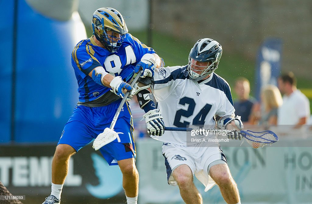 John Grant, Jr. #24 of the Chesapeake Bayhawks is checked by Joe Cinosky #84 of the Charlotte Hounds at American Legion Memorial Stadium on June 22, 2013 in Charlotte, North Carolina. The Hounds defeated the Bayhawks 16-15 in overtime.