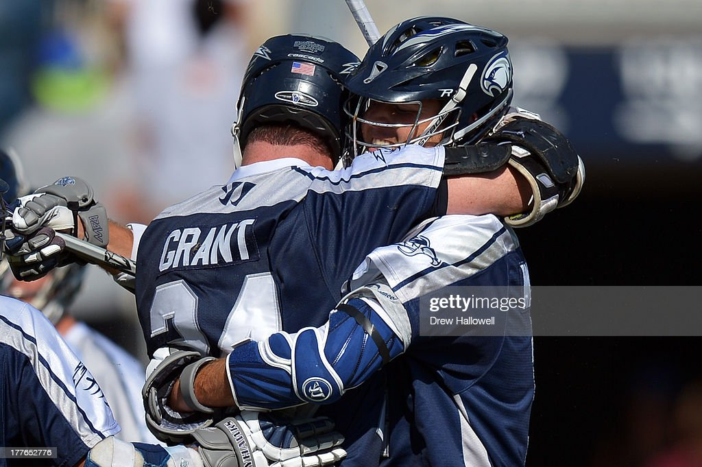 John Grant Jr. #24 of the Chesapeake Bayhawks is congratulated on a goal by teammate <a gi-track='captionPersonalityLinkClicked' href=/galleries/search?phrase=Drew+Westervelt&family=editorial&specificpeople=5894297 ng-click='$event.stopPropagation()'>Drew Westervelt</a> #14 against the Charlotte Hounds during the MLL Championship at PPL Park on August 25, 2013 in Chester, Pennsylvania. Chesapeake won 10-9.