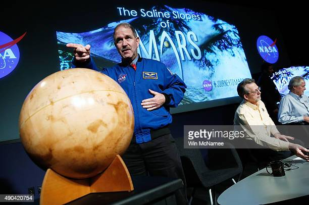 John Grunsfeld associate administrator at NASA's Science Mission Directorate speaks with colleagues at a press conference where NASA announced new...