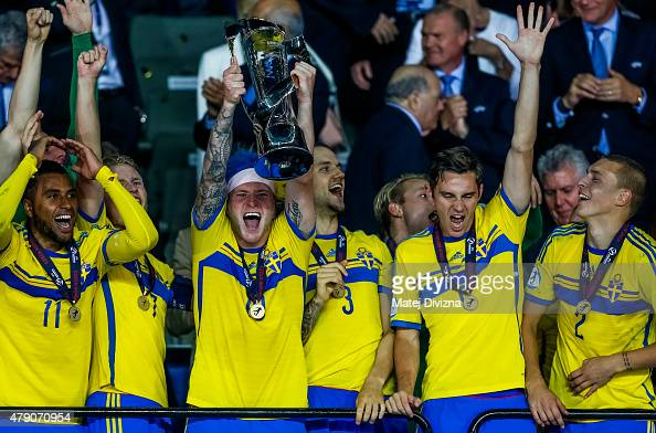 John Guidetti lifts up trophy after Swedish victory in UEFA U21 European Championship final match between Portugal and Sweden at Eden Stadium on June...