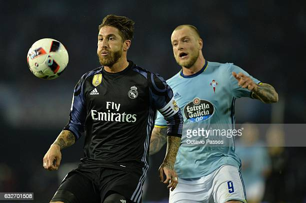 John Guidetti of Celta de Vigo competes for the ball with Sergio Ramos of Real Madrid during the Copa del Rey quarterfinal second leg match between...