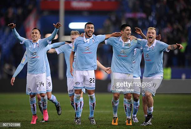 John Guidetti of Celta Vigo celebrates with Fabian Orellana and Gustavo Cabral after Celta beat Club Atletico de Madrid 32 in the Copa del Rey...