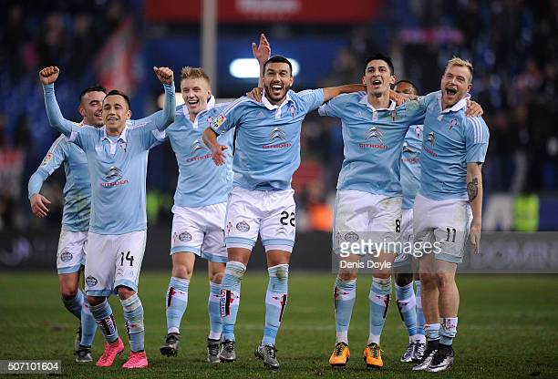 John Guidetti of Celta Vigo celebrates with Fabian Orellana Gustavo Cabral and Pablo Hernandez after Celta beat Club Atletico de Madrid 32 in the...