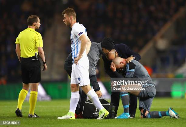John Guidetti of Celta Vigo is given assistance during the UEFA Europa League quarter final second leg between KRC Genk and Celta Vigo at Luminus...