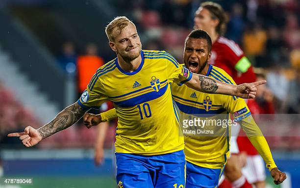John Guidetti of Sweden celebrates his goal with his teammate Isaac Kiese Thelin during UEFA U21 European Championship semi final match between...