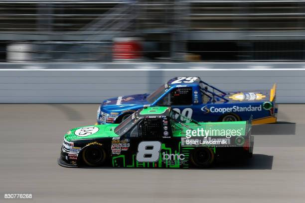 John H Nemechek driver of the Fire Alarm Services Inc Chevrolet races Chase Briscoe driver of the Cooper Standard Ford during the NASCAR Camping...