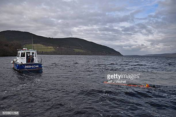 John Haig an engineer monitors a Munin robot operated by Norwegian company Kongsberg Maritime in Loch Ness on April 13 2016 in Drumnadrochit Scotland...