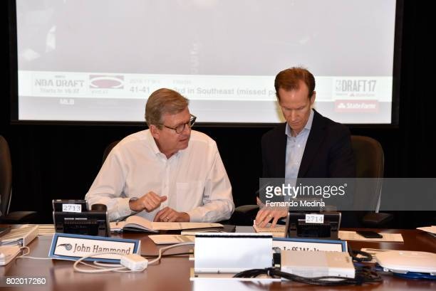 John Hammond and Jeff Weltman of the Orlando Magic talk in the war room during the 2017 NBA Draft on June 22 2017 at Amway Center in Orlando Florida...