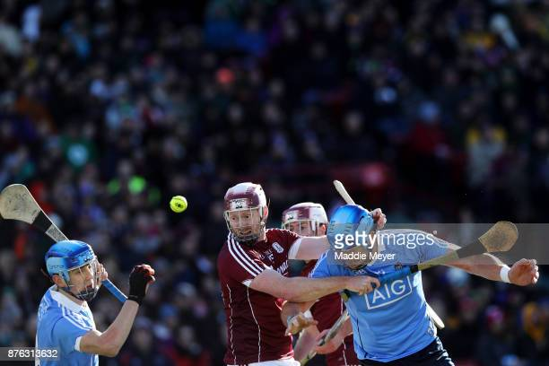 John Hanbury of Galway battles for a control of the ball against Paul Crummy left and John Hetherton right of Dublin during the 2017 AIG Fenway...