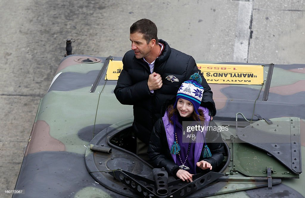 John Harbaugh, head coach of Super Bowl champions Baltimore Ravens, greets fans during the Ravens Victory Parade in Baltimore on February 5, 2013. The Ravens defeated the San Francisco 49's in the Super Bowl to win the NFL Championship in New Orleans on February 3. AFP PHOTO/Molly RILEY