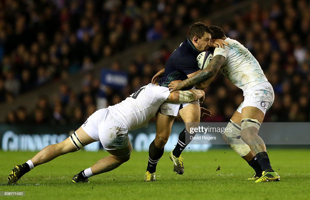 John Hardie of Scotland is tackled by Jack Clifford and <a gi-track='captionPersonalityLinkClicked' href=/galleries/search?phrase=Courtney+Lawes&family=editorial&specificpeople=5385543 ng-click='$event.stopPropagation()'>Courtney Lawes</a> of England during the RBS Six Nations match between Scotland and England at Murrayfield Stadium on February 6, 2016 in Edinburgh, Scotland.