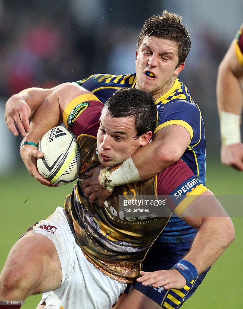 John Hardie of Southland is tackled by Teihorangi Walden of Otago during the ITM Cup match between Southland and Otago on August 30, 2014 in Invercargill, New Zealand.