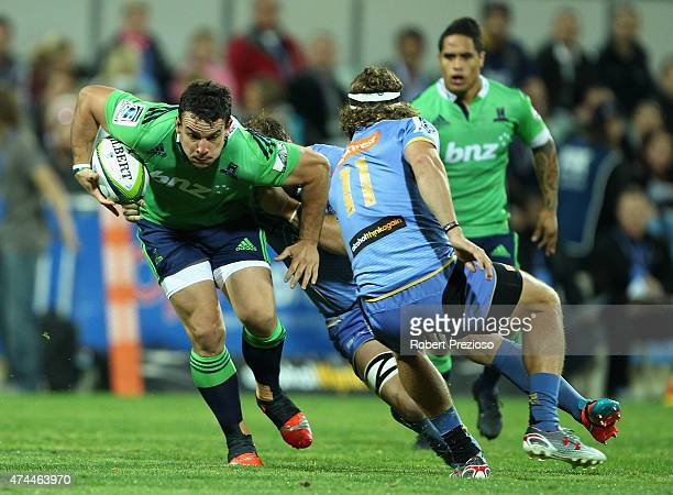 John Hardie of the Highlanders is tackled during the Super Rugby round 15 match between the Force and the Highlanders at nib Stadium on May 23 2015...
